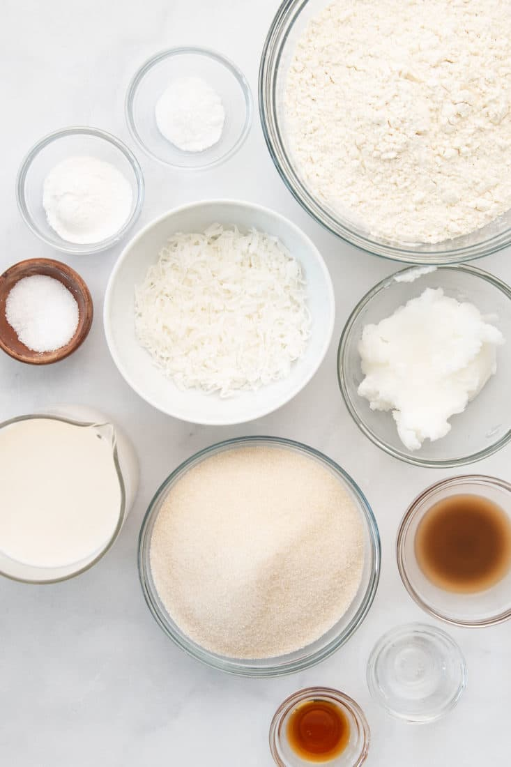 ingredients for vegan coconut cake on marble background
