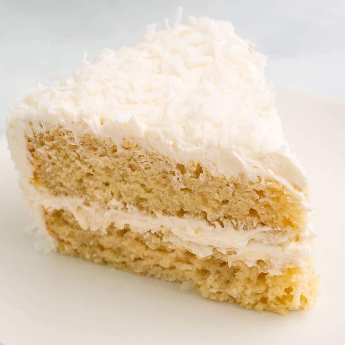 slice of vegan coconut cake on plate