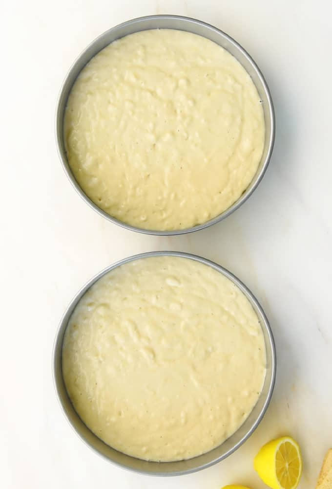 vegan lemon cakes in cake pans before being baked