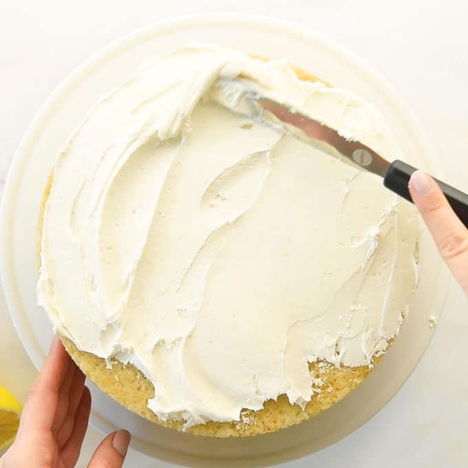 hands frosting vegan lemon cake