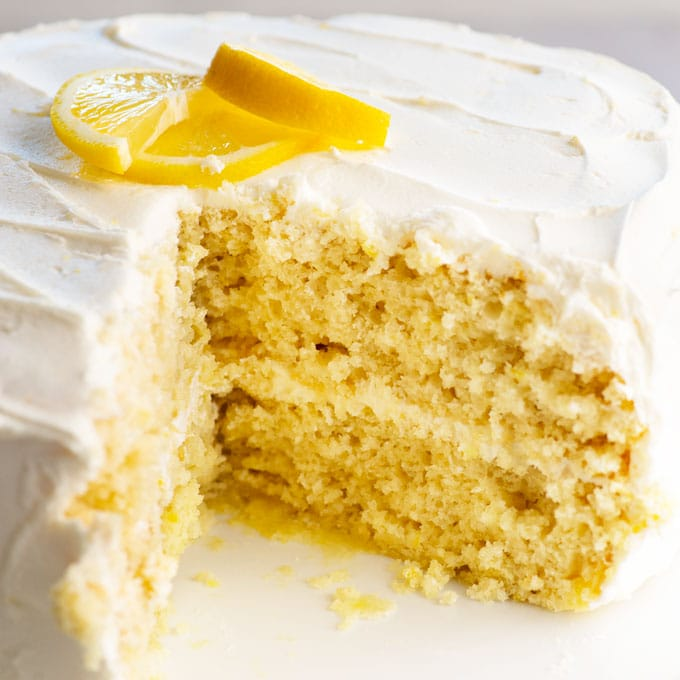 vegan lemon cake with slice taken out