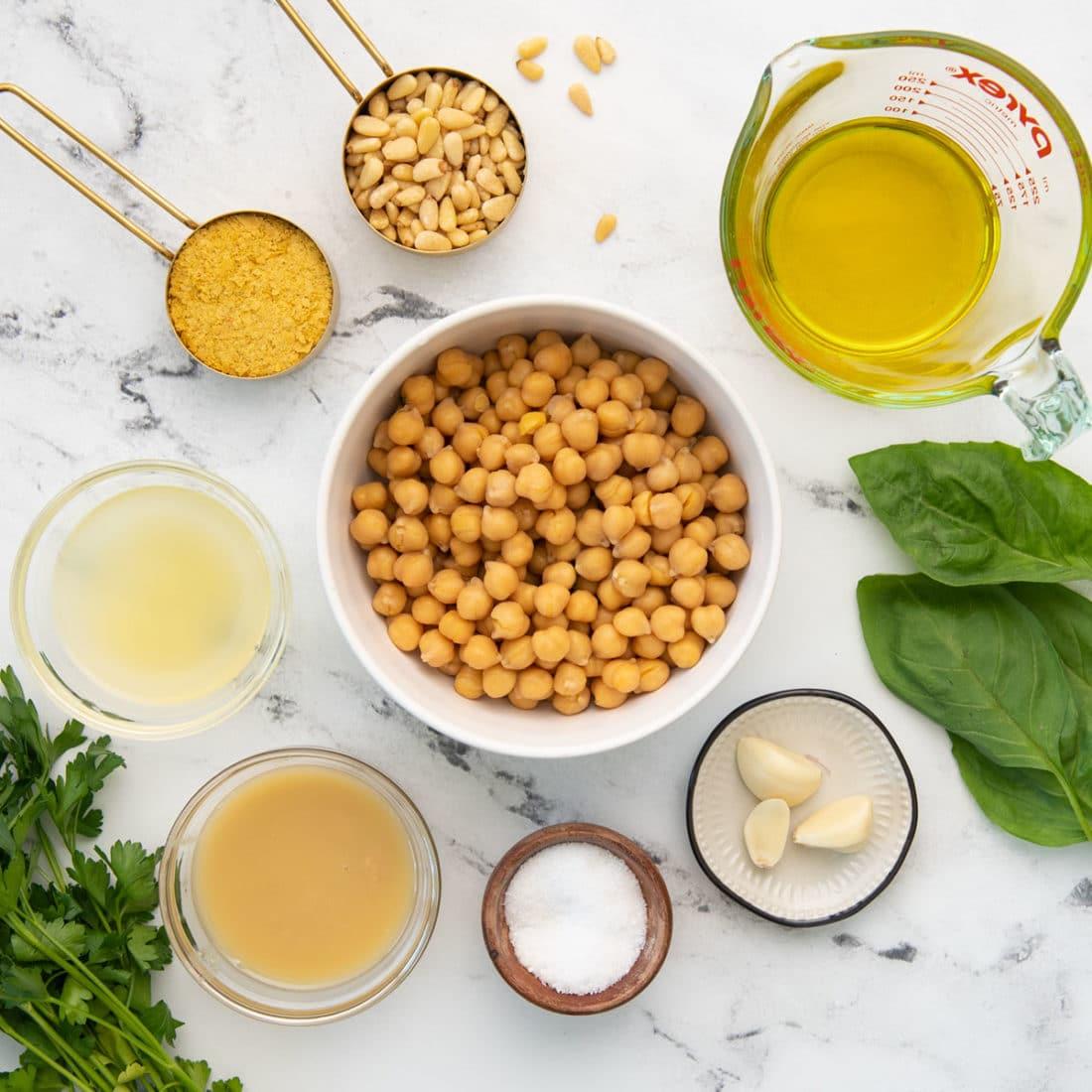chickpeas, basil, nutritional yeast, garlic, olive oil, tahini paste, lemon juice