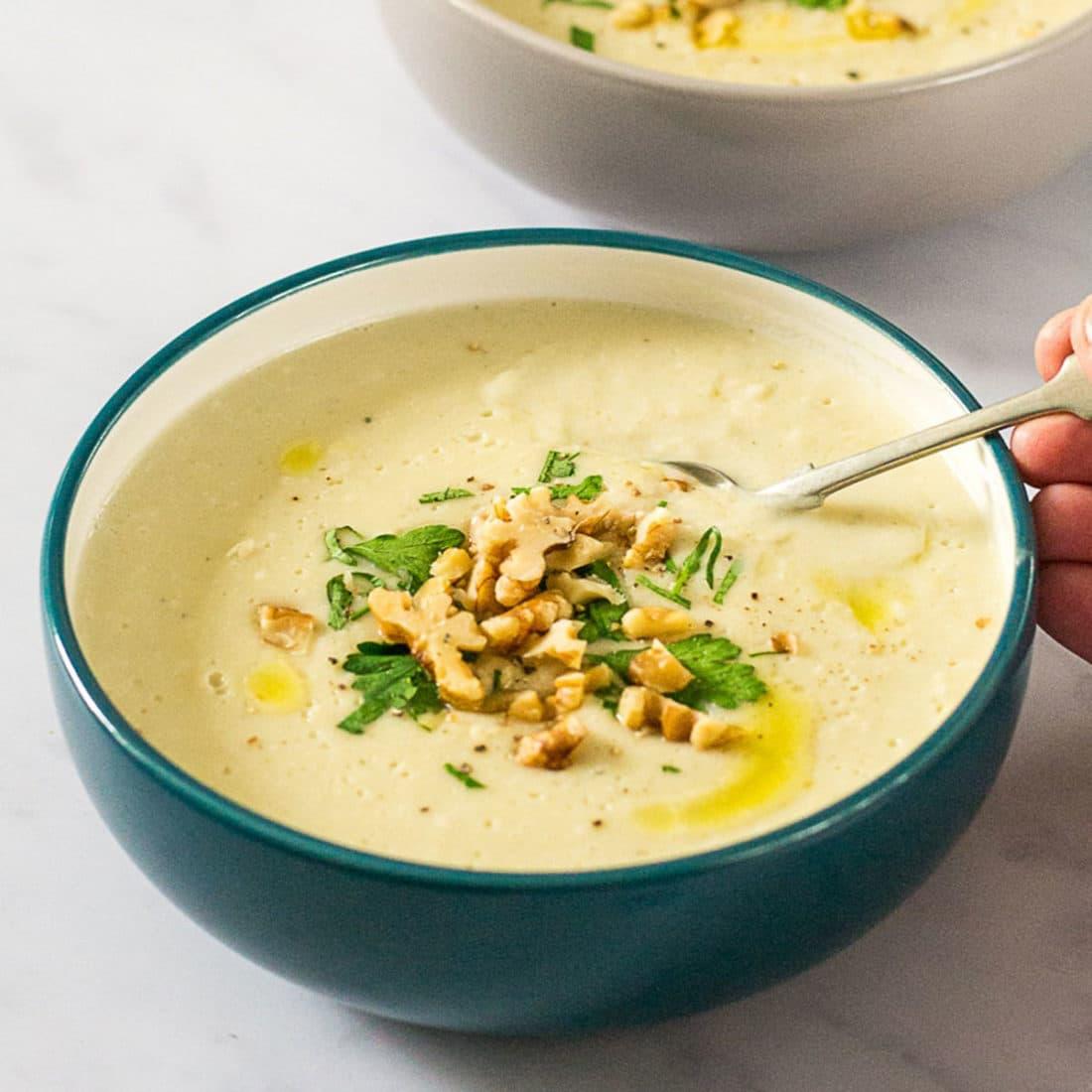 artichoke parsnip soup in blue bowl