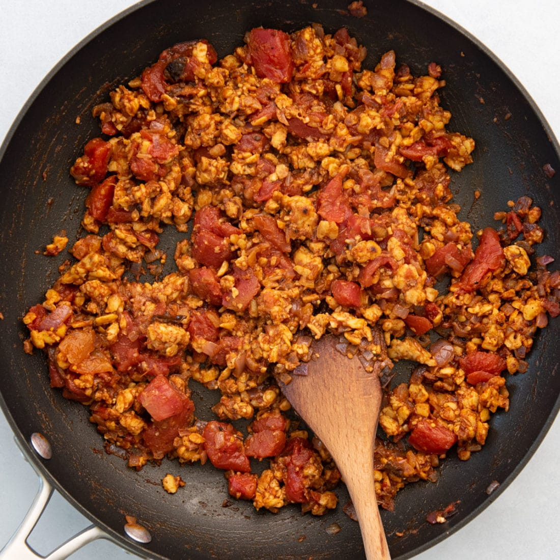 crumbled veggie meat with tomatoes and seasoning