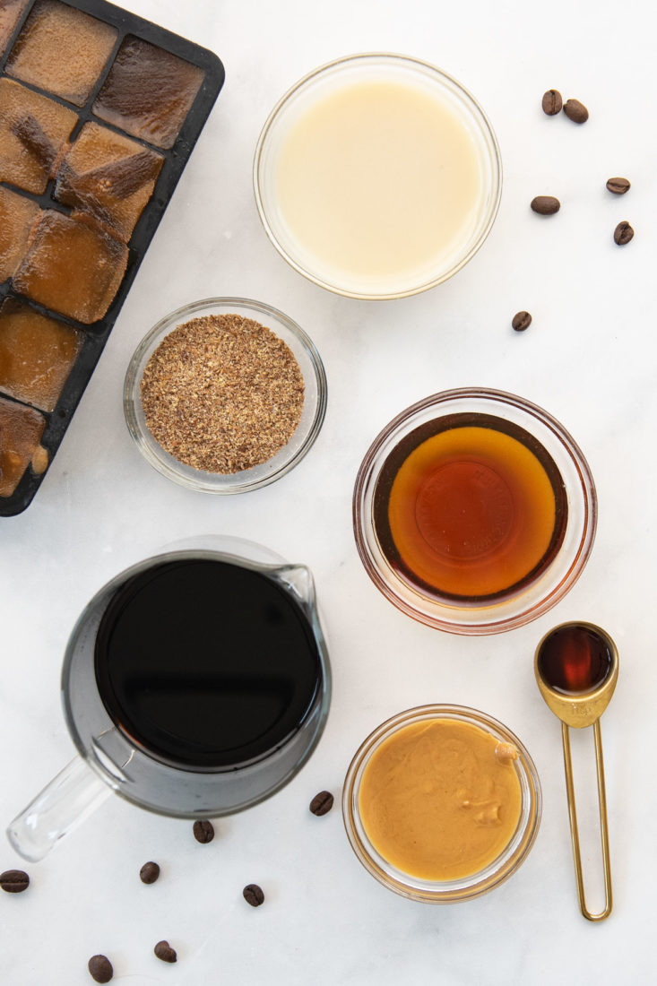 cold brew ice cubes, maple syrup, flaxseed, oat milk, cold brew, peanut butter, vanilla extract