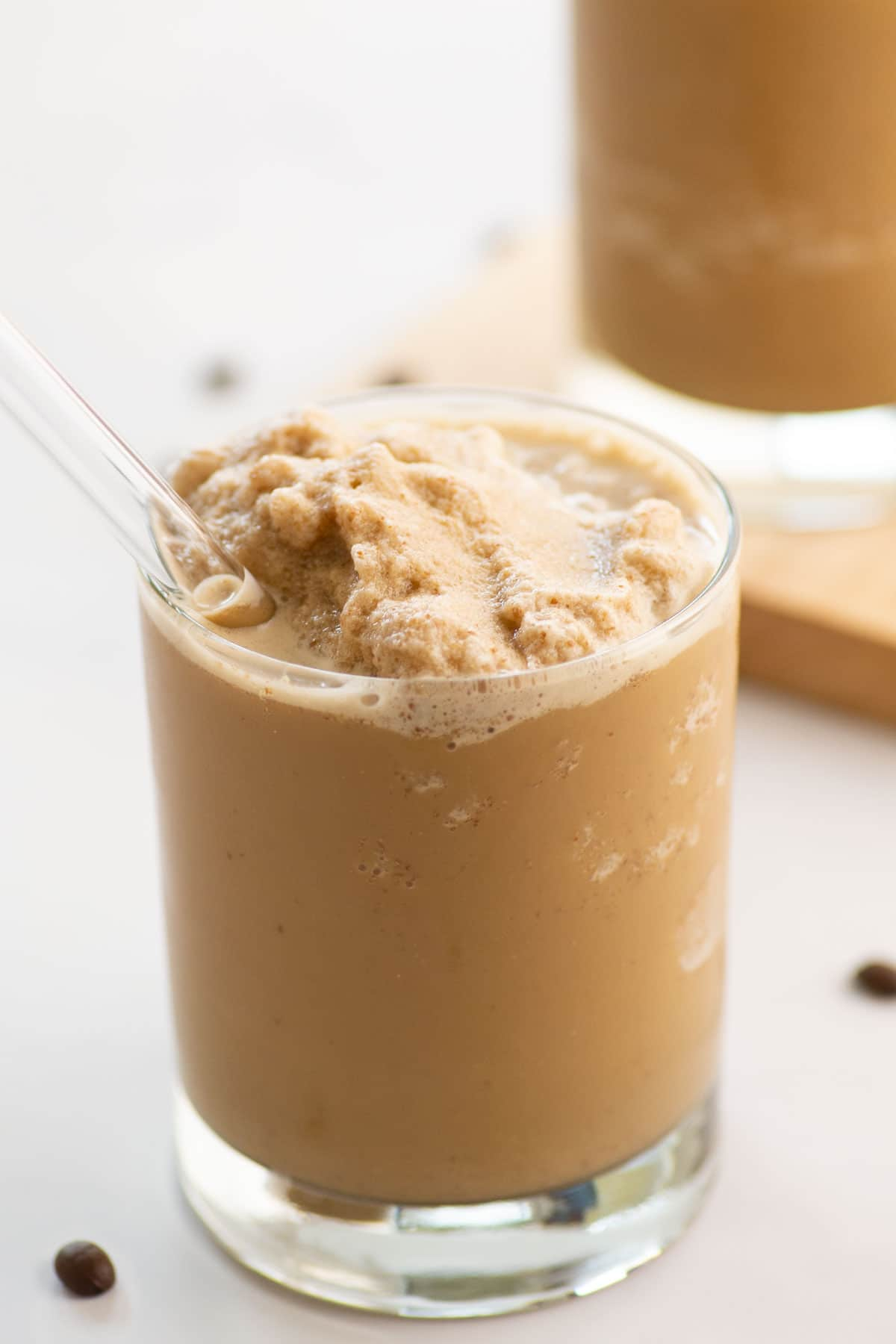 blended coffee smoothie with glass straw