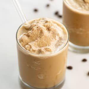 close up of vegan coffee smoothie in glass