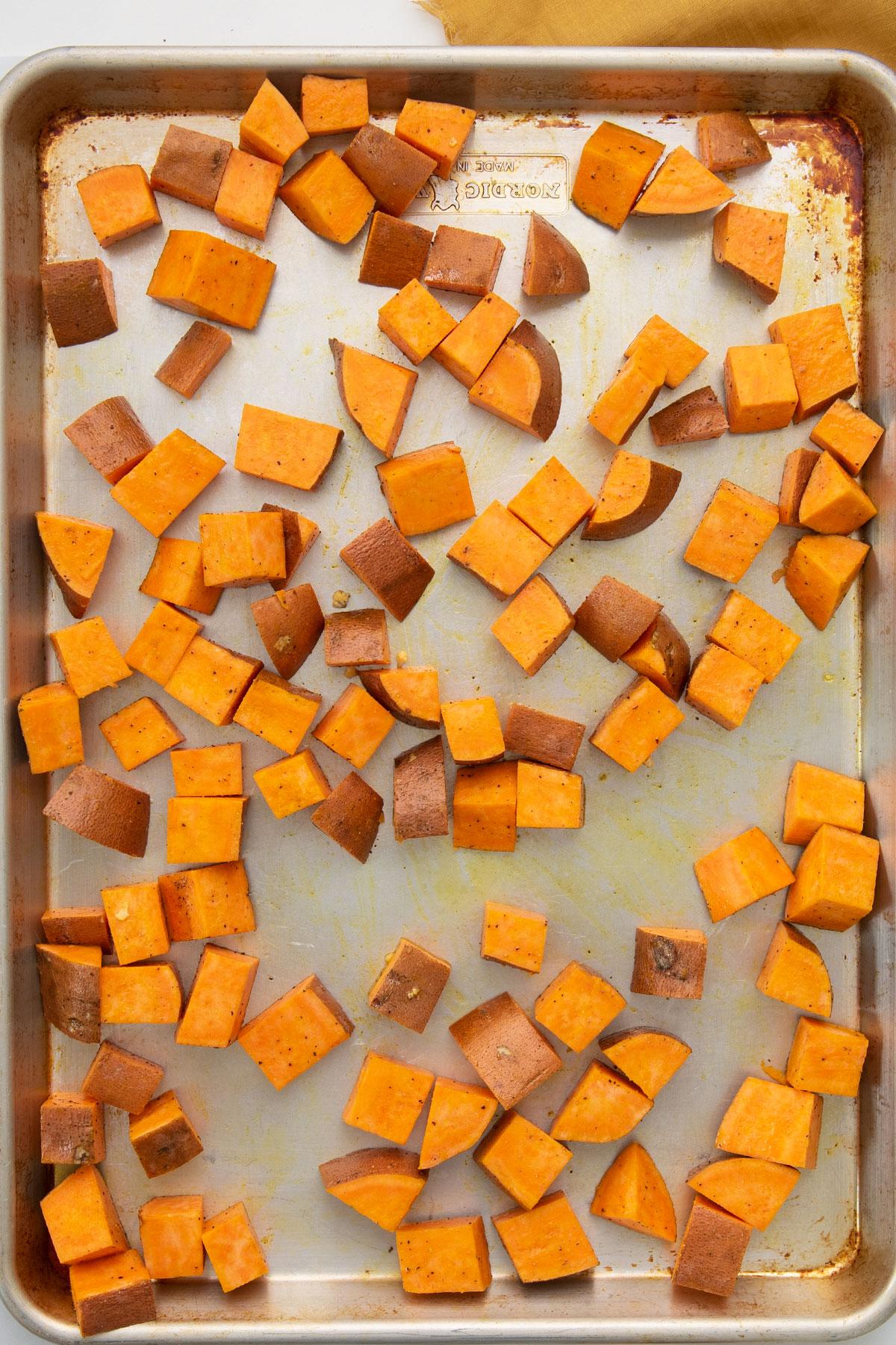 chunks of sweet potatoes on a baking sheet
