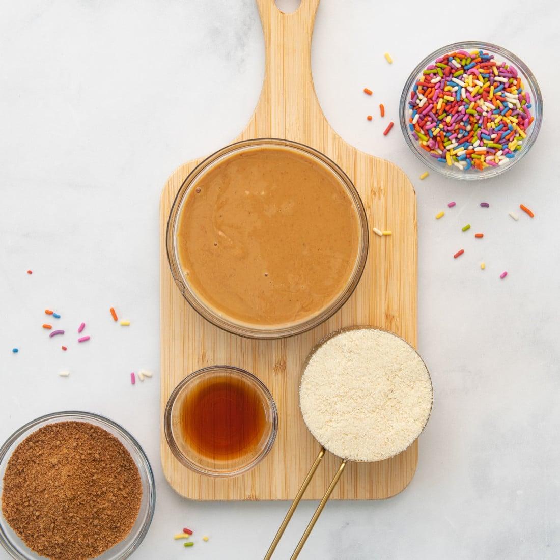 sprinkles, nut butter, almond flour, sugar on a board