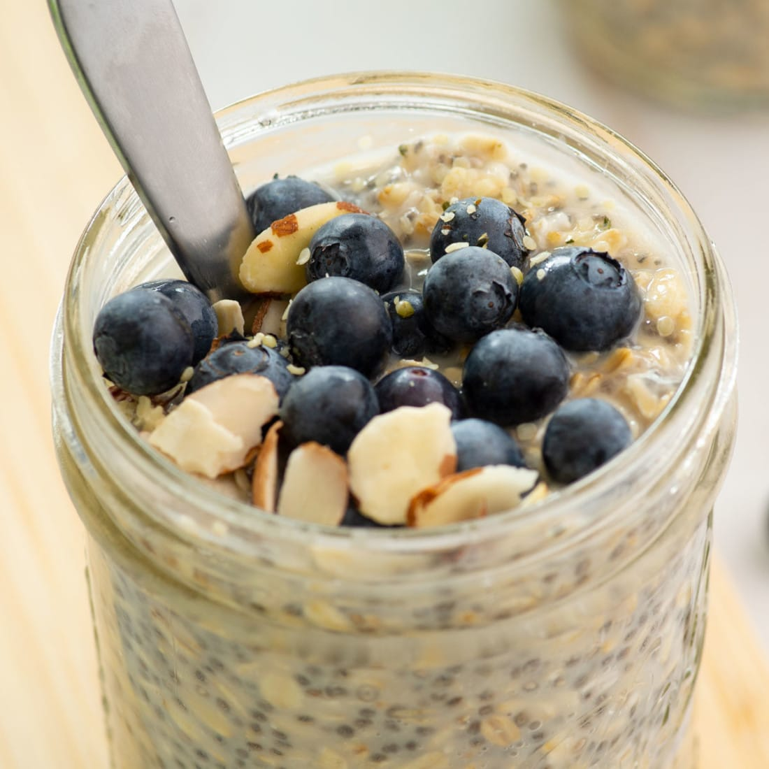 close up of vegan overnight oats with blueberries and almonds