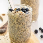 overnight oats in jar with spoon topped with blueberries and almonds