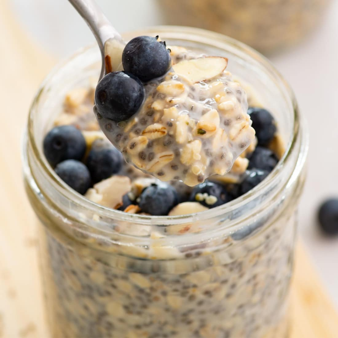 jar of vegan overnight oats with spoon scooping