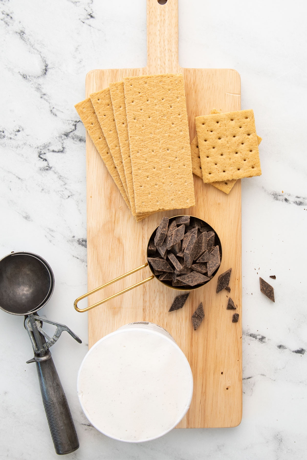 large board with graham crackers, chocolate chunks, and soy ice cream