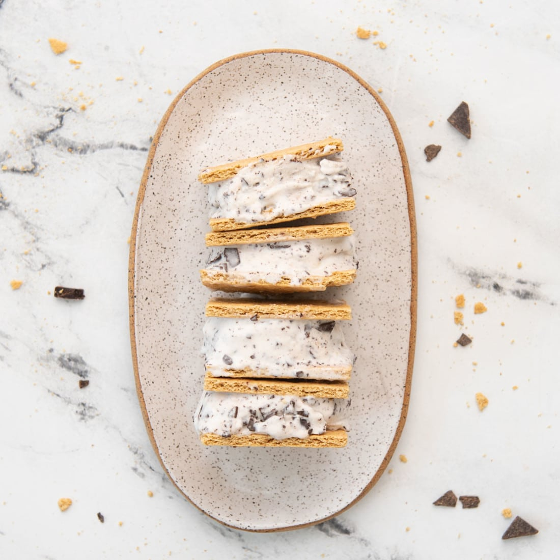 overhead view of four s'mores ice cream sandwiches on a platter