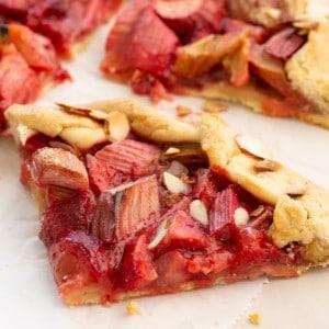 close up slice of vegan strawberry rhubarb galette
