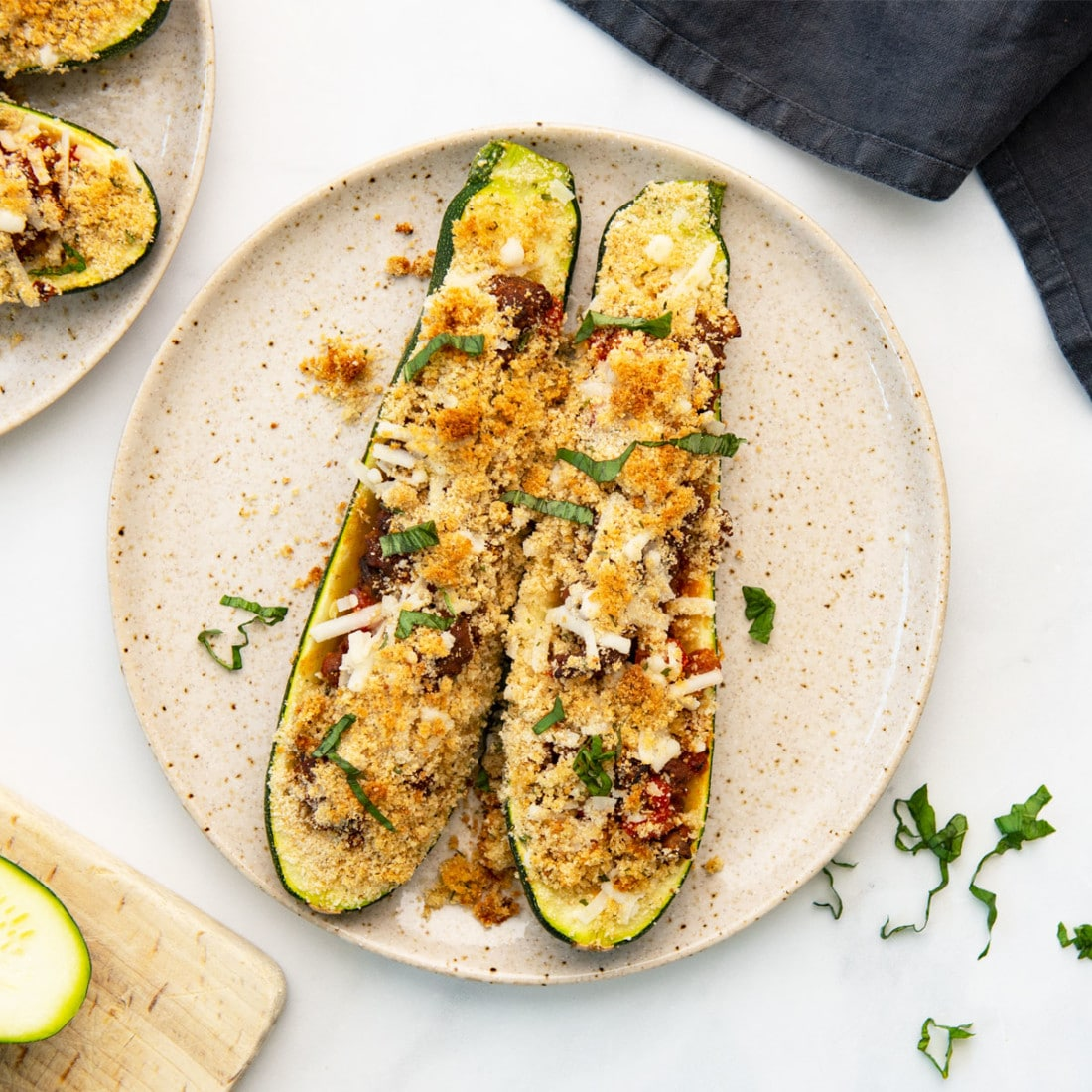 overhead view of baked vegan zucchini boats on a plate