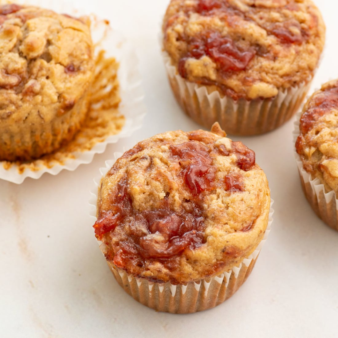 side view of vegan muffins made with peanut butter and jelly