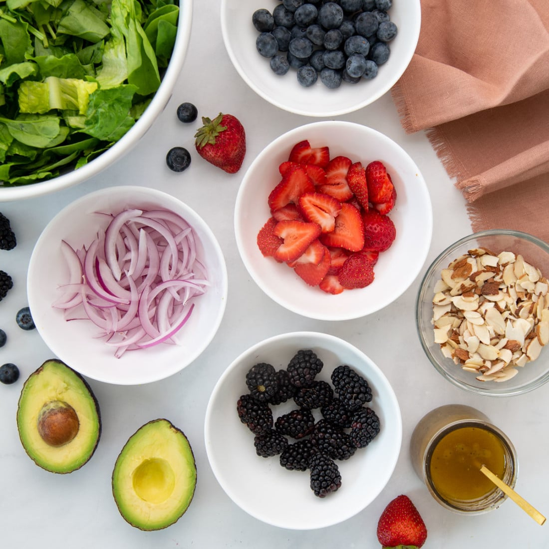 ingredients for berry salad on white background