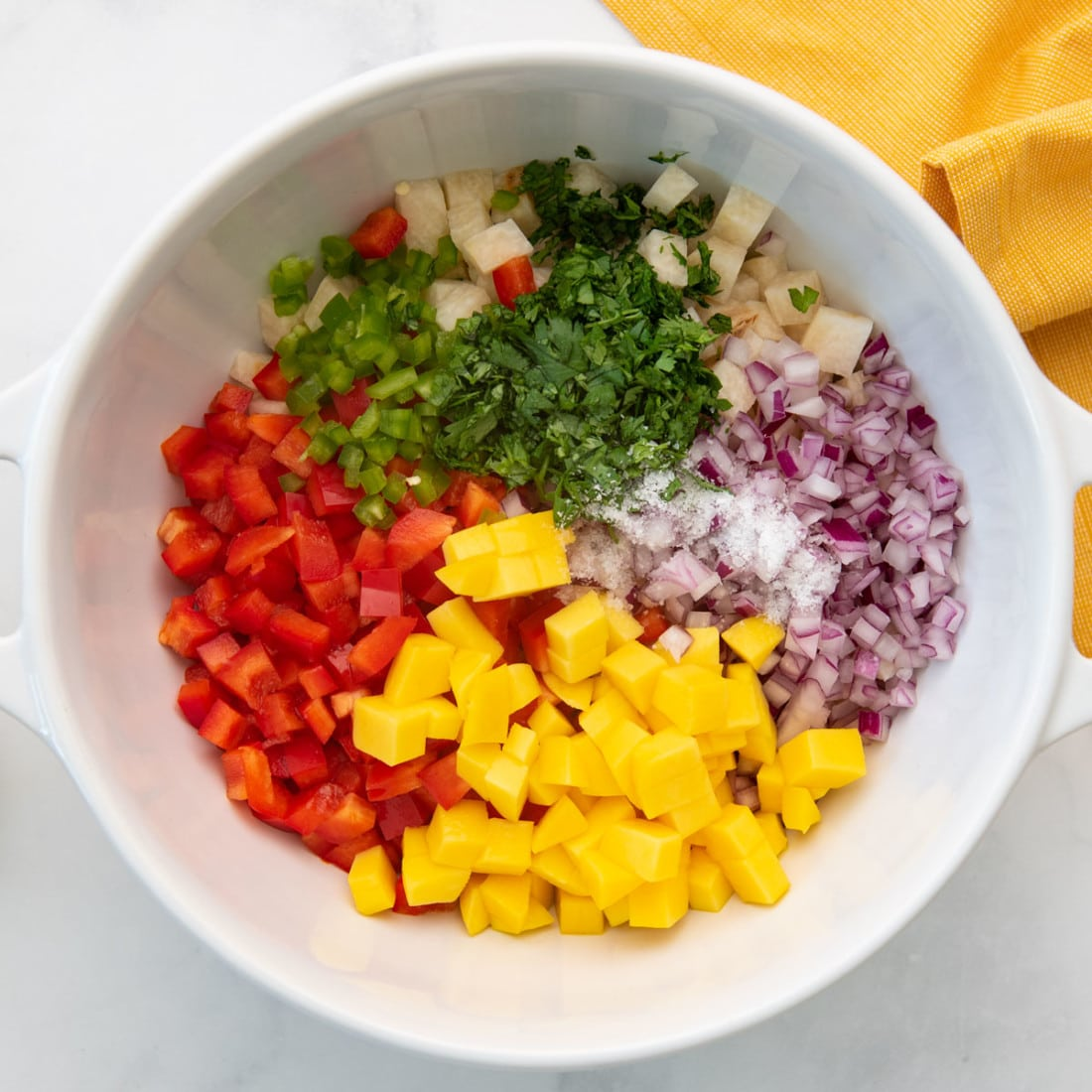 bowl with chopped produce and seasoning