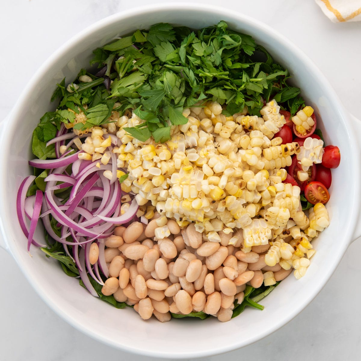 ingredients for summer market salad in large mixing bowl