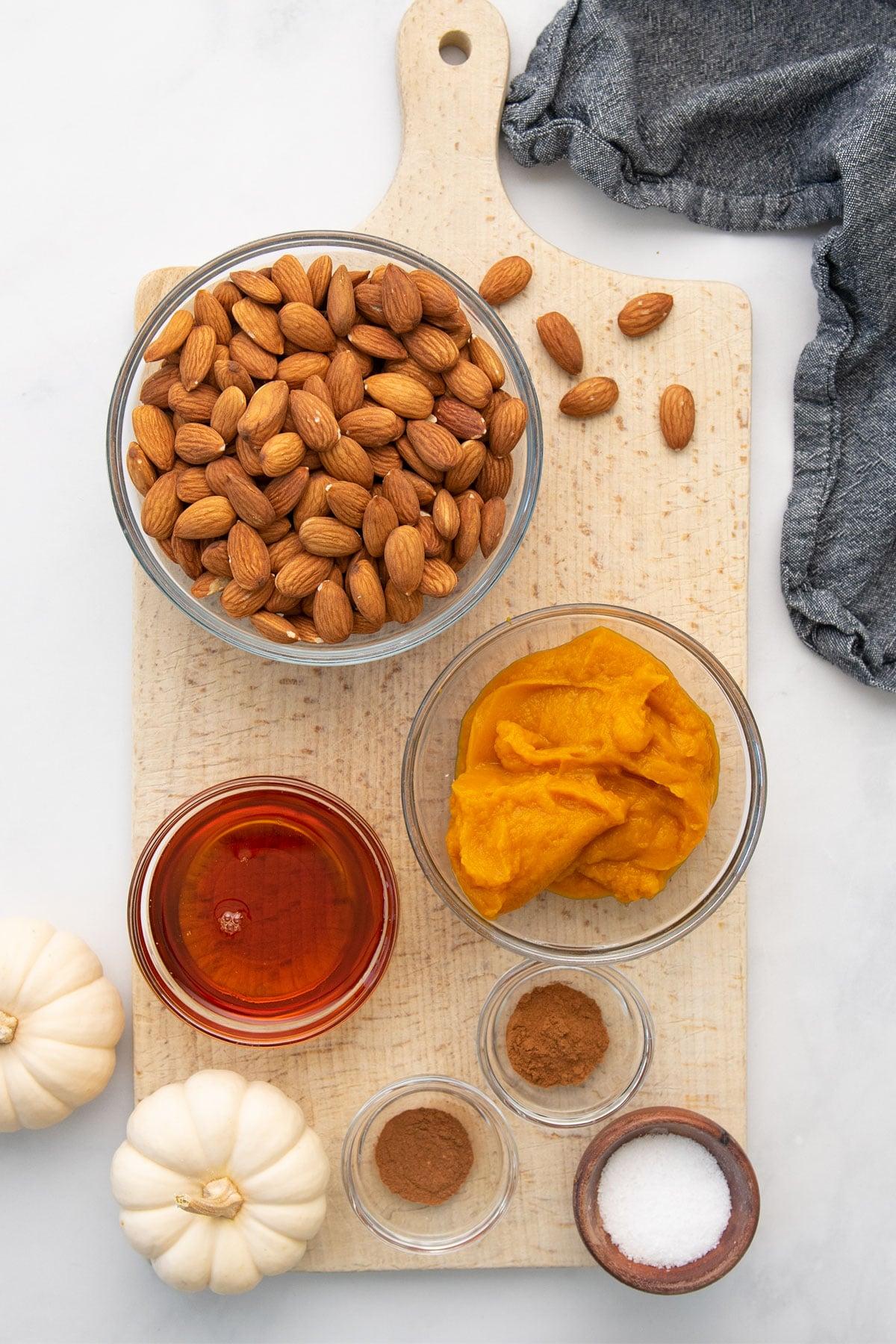 ingredients for pumpkin almond butter on wood board