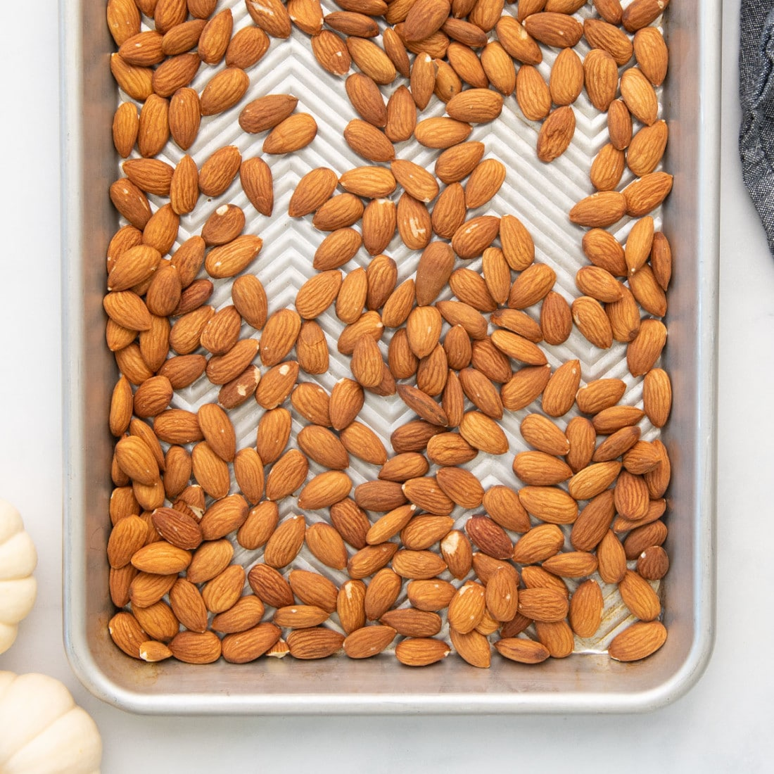 raw almonds on baking sheet